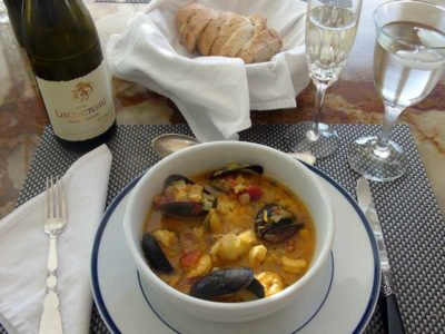 A beautiful table setting featuring Bouillabaisse