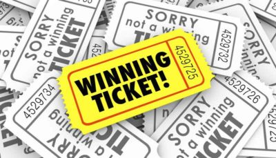 A winning ticket can be seen in yellow over a pile of losing tickets.
