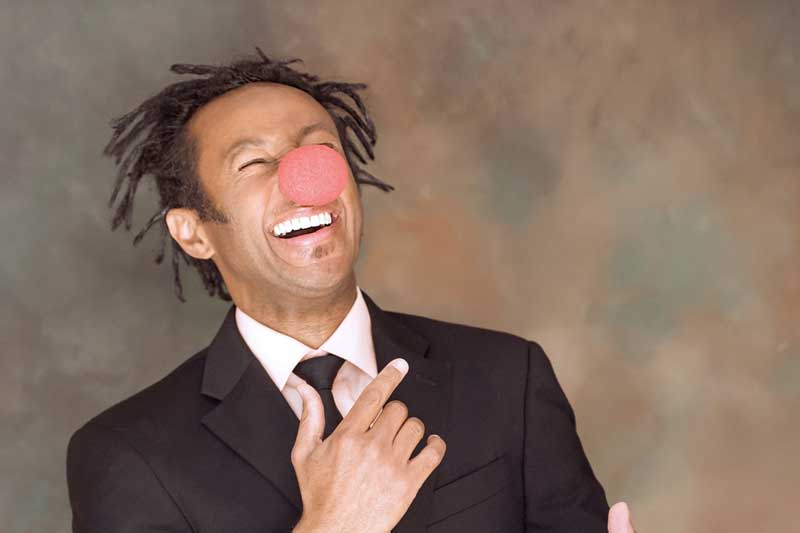 Vital Germaine laughs while wearing a clown nose.